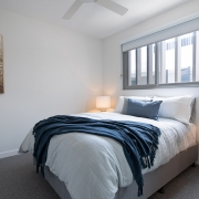 Bedroom with one double bed at Thalassa Beachfront Penthouse Coolum holiday homes.