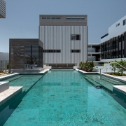 Crystal blue pool at Thalassa Beachfront Penthouse Coolum holiday homes.