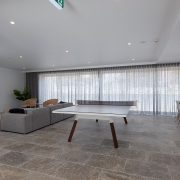 Indoor lounge and gaming area at Thalassa Beachfront Penthouse Coolum holiday homes.