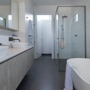 Modern day bathroom at Thalassa Beachfront Penthouse Coolum holiday homes.