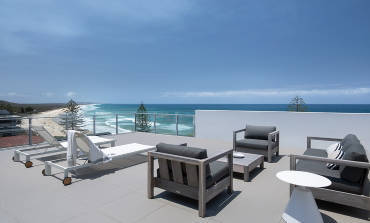 Modern outdoor terrace overlooking Coolum Beach at Thalassa Beachfront Penthouse Coolum.