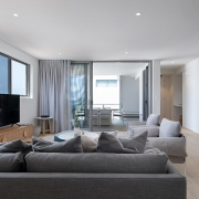 Lounge room that flows out to terrace at Thalassa Beachfront Penthouse Coolum holiday homes.