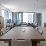 Dining and living room at Thalassa Beachfront Penthouse Coolum holiday homes.