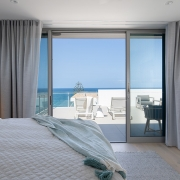 Bedroom looking out at ocean view at Thalassa Beachfront Penthouse Coolum holiday homes.