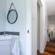 View of sink and hallway at The Pool House Coolum Beach holiday home rentals.