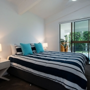 Bedroom that flows out onto backyard at The Pool House Coolum Beach holiday home rentals.