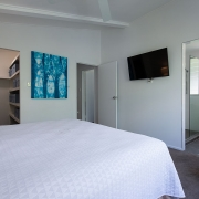 Bedroom at The Pool House Coolum Beach holiday home rentals.