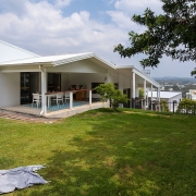 Elevated backyard at top of house at The Pool House Coolum Beach holiday home rentals.