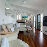 Entertainment area with large flatscreen TV at The Pool House Coolum Beach holiday home rentals.