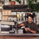 Barista pouring coffee | Featured image for Best Cafes Sunshine Coast - Our Top Picks | Blog